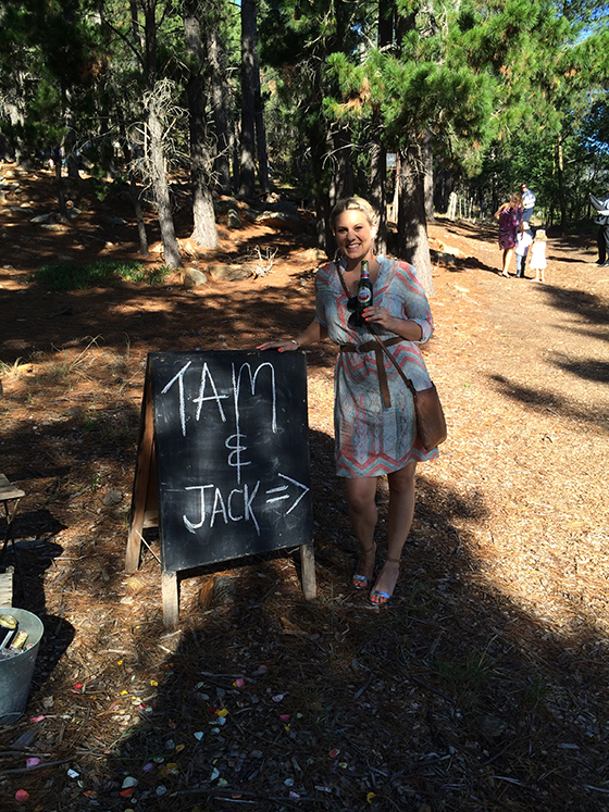 Amy and the sign at Tam's wedding